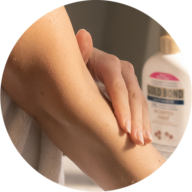 Image of person applying lotion to arm.